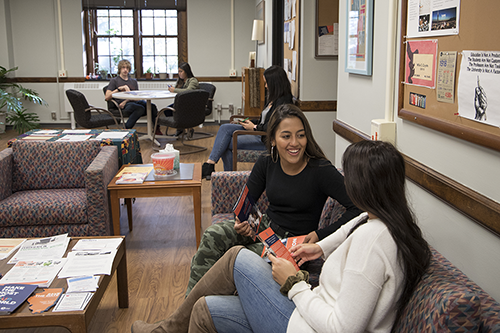 Students Issy Marquez and Ariana Daneshbodi talk in the Humanities Professional Resource Center.